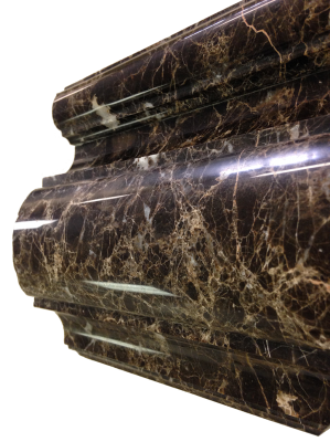 A custom edge on dark emperador marble.