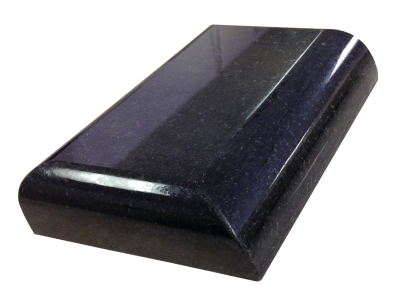 An eased edge and a demi-bullnosed edge on absolute black granite.
