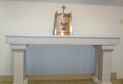 An altar made of botticino marble.