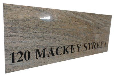 Inlaid sign made out of juparana maraviglia granite.
