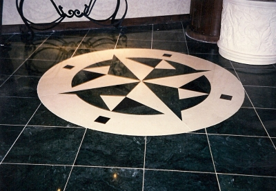 Inlaid logo made out of thassos marble.