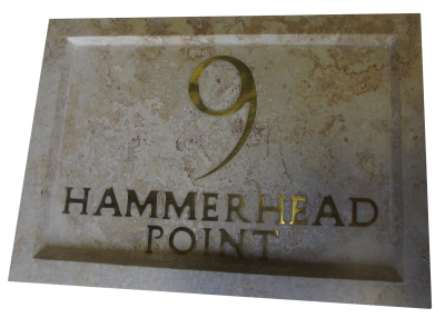 Inlaid sign made out of coralina limestone.