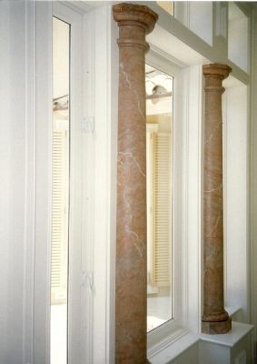 Turned columns split into pilasters.
